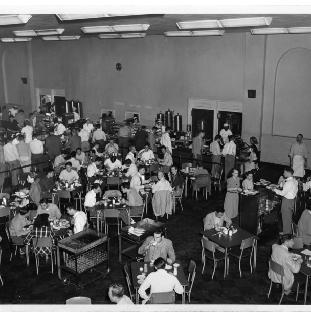 Interior view of students dining in Leazar Hall's East Cafeteria at North Carolina State College. The building served as the campus dining hall until 1971.