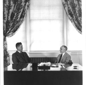 Dean John William Harrelson and UNC President Frank Porter Graham at desk