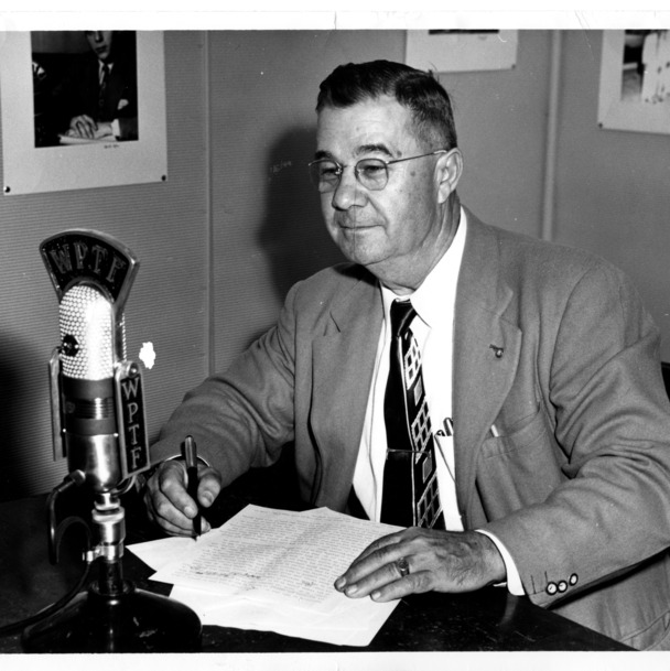 F. H. Jeter, director of the Department of Agricultural Information at North Carolina State College, sitting at microphone in WPTF radio studio.