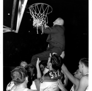 Coach Case cuts the net