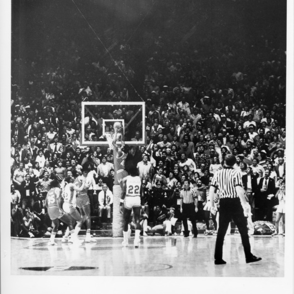 North Carolina State University's Lorenzo Charles dunks winning basket in 1983 NCAA championship game against Houston, April 3, 1983.