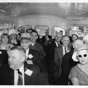 North Carolina State College alumni taking a bus tour of the campus during Alumni Weekend, May 1957.