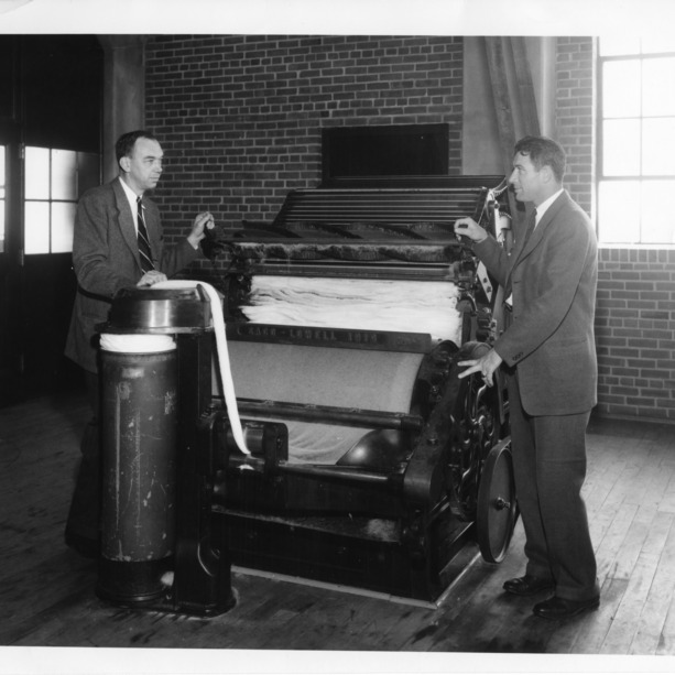 Professor Elliot B. Grover and George H. Dunlap at a cotton card in the School of Textiles