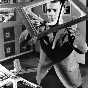 William R. Mitchell with model of his aluminum structural unit for a Peace Corps educational unit, which won the 1966 Reynolds Aluminum Prize for Architectural Students