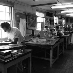View of students working at drafting tables in classroom at North Carolina State College School of Design.