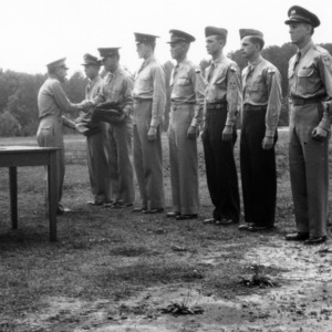 Samuel A. Gibson presenting cadets with awards