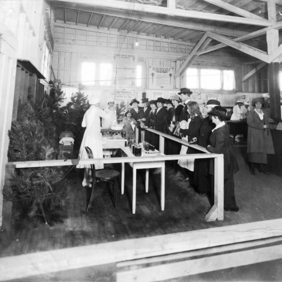 Demonstration with grape products by the home demonstration division, 1922.