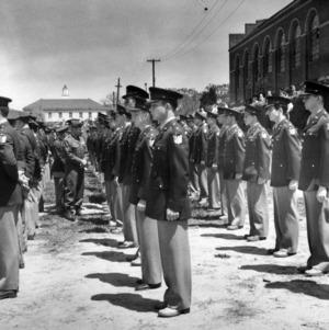Officers inspect cadets standing in formation