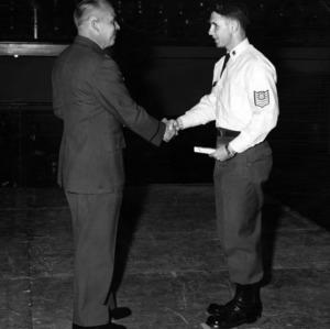 Officer giving cadet an award