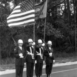 Cadets bearing flags at ceremony