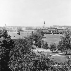 Bird's-eye view of North Carolina State College campus showing 1911 Building and water tower in distance