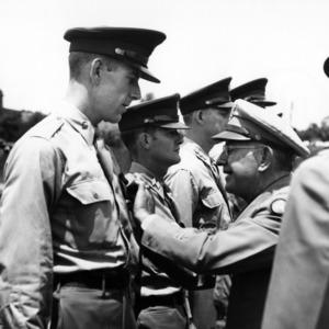 Samuel A. Gibson pinning a medal on a cadet