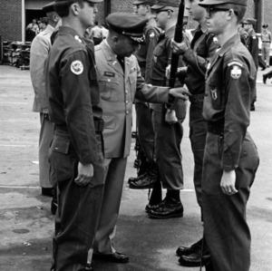 Officers inspect cadets artillery