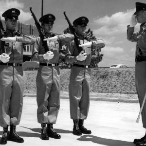 Armed cadets standing at attention