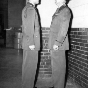 Officer and cadet standing at attention