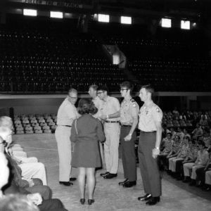 Officer presenting cadets with awards