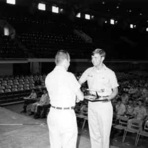 Officer presenting a cadet with an award
