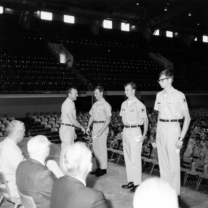 Officer presenting a cadets with an awards