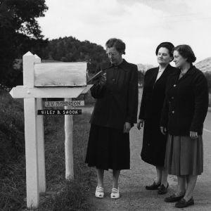 Three women checking mailbox on Buncombe County rural road