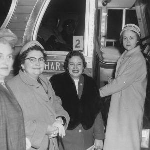 Four women boarding bus