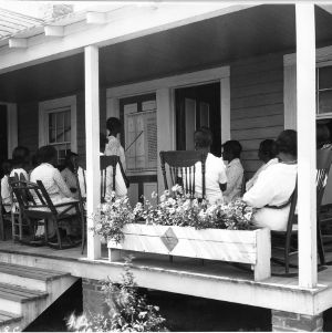 Dress making instruction to African American home demonstration club members, 1930s