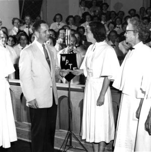 Presentation of the WPTF choral award at the 1952 Farm and Home Week.
