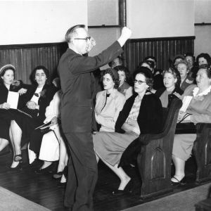 Music director Dr. Arnold E. Hoffman and assistants training for home demonstration club music project