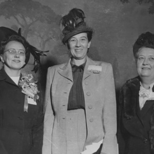 Three women in formal dress