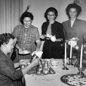 Four Home Demonstration women attending a tea party