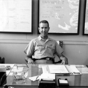 Colonel Samuel C. Schlitzkus at desk