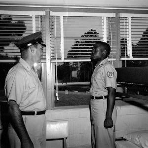 Officer inspecting cadet's bunk