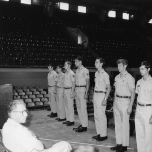 Cadets standing at attention in front of officers