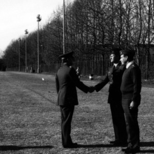 Military officers greeting one another on the field
