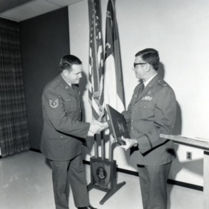 Officer presenting cadet with an award