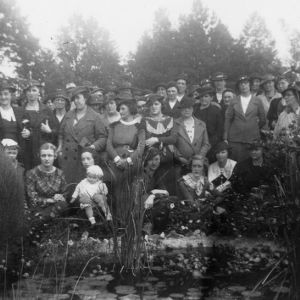 Group of women standing behind a small pond in Alamance County on the Farm Food Supply Tour of November 1934