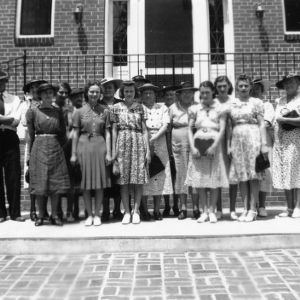 Group of women from the Amity Club of Iredell, North Carolina, posing on a sightseeing tour of Statesville, North Carolina