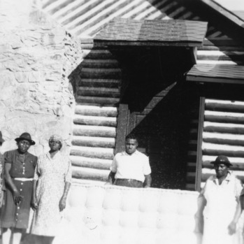 Farm women and a worker standing in front of the Person County rural center in October 1940