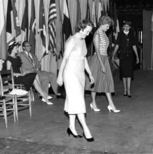 Home demonstration women practicing how to walk and stand in the charm school held during the 1959 Farm and Home Week.