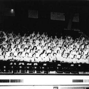 Group of women singing in a chorus