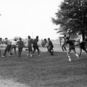 Military cadets playing football