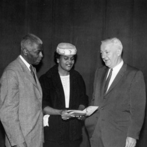 Two men and a woman at State Council Meeting for African American Home Demonstration Clubs, 1959