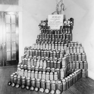 A display of canned fruits and vegetables canned by people on relief and directed primarily by home demonstration club women, Sexton garden, Durham county, North Carolina, 1933