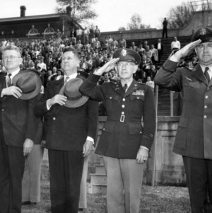 Officers standing and saluting