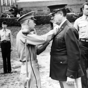 Officer awarding fellow officer with a medal