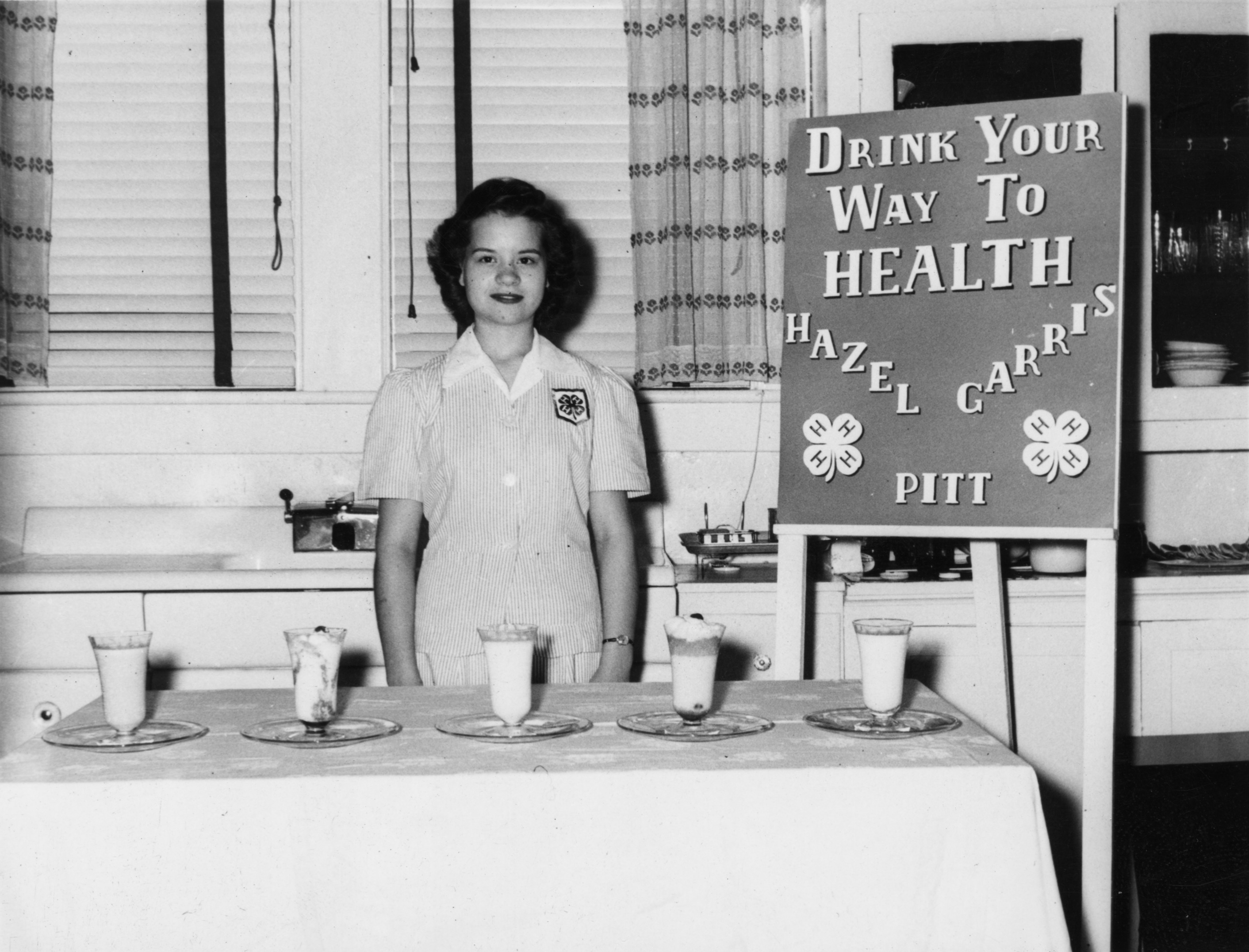 "Hazel Carris of Pitt County at her 4-H exhibit, ""Drink Your Way to Health"""