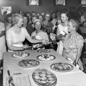 Familiar Foods in Fancy Fashion presentation by Ann Russell, American Institute of Baking, Chicago, Ill., with club women, 1957 Farm Home Week