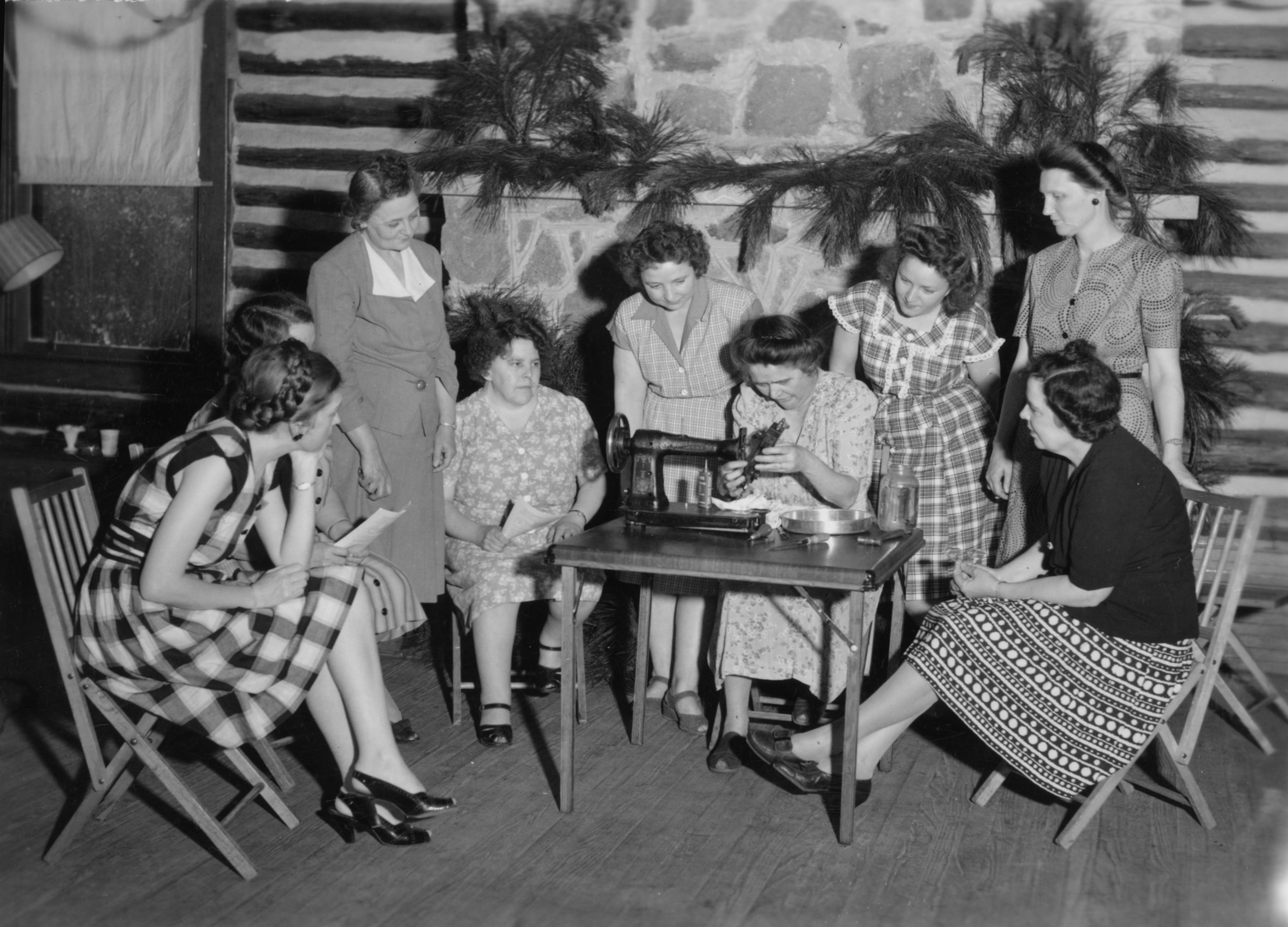 Group of women watching a sewing demonstration