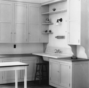 Interior view of a kitchen centering on the sink