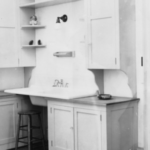 Interior view of a kitchen, centering on the sink