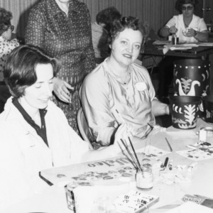 Group of women attending a decorative painting activity